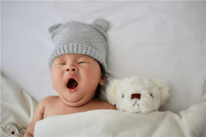 A baby's gray knit hat