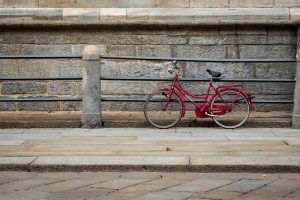 Red bike next to a wall