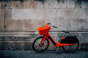 Red bicycle next to a wall