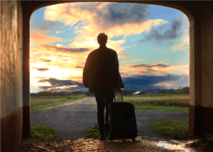 A man holding luggage photo