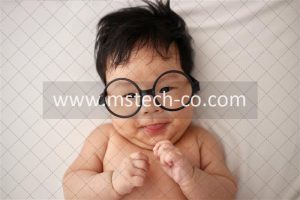 baby using white eyeglasses photo