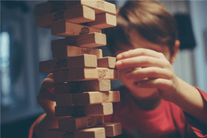 boy playing jenga photo
