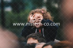 girl making hand gesture on her face photo