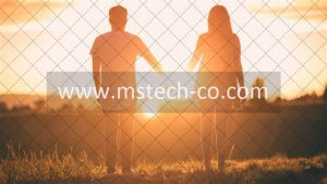 man and woman holding hands white facing sunset photo
