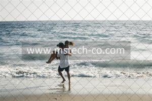 man carrying woman on seashore photo