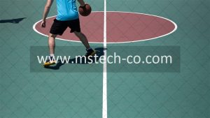 man dribbling ball on court photo
