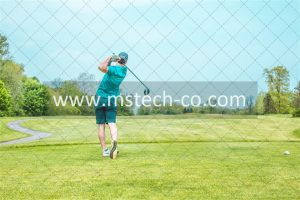 man playing gold under blue sky during daytime photo