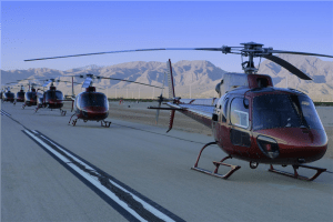 photography of red helicopters on road during daytime photo