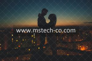 silhouette of man and woman standing on roof building photo