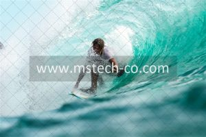 time lapse photography surfer in wave water photo