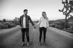woman and man standing on concrete road photo