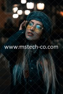 woman in black jacket wearing blue framed eyeglasses