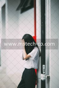 woman leaning on white concrete well
