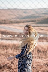 woman standing in brown field