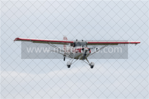 flying red and white biplane during daytime photo