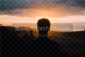 silhouette of a man facing the sunset photo