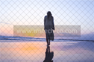 woman standing on beachfront photo